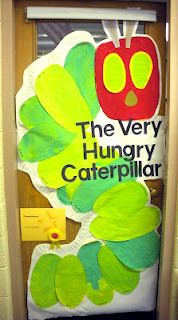 Very Hungry Caterpillar door decoration inspired by the artwork of Eric Carle. Have each student paint an oval, then construct into a caterpillar. Great activity for Reading Month! doors, classroom door, eric carle door decorations, birthday idea, book, hungry caterpillar, eric carle decorations, eric carle classroom decor, hungri caterpillar