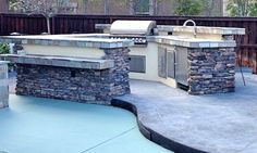 Beautiful stone exterior kitchen with adjoining dining area