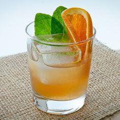 Window Pane: oz Michter's Sour Mash Whiskey oz Solerno Blood Orange Liqueur oz Fresh lemon juice oz Rich simple syrup (two parts sugar, one part water) 5 Mint leaves Glass: Double Old Fashioned Garnish: Blood orange wheel and mint sprig PREPARATION: Tom Collins Cocktails, Spring Cocktails, Whiskey Cocktails, Vodka Cocktails, Classic Cocktails, Refreshing Drinks, Fun Drinks, Beverages, Orange Wheels