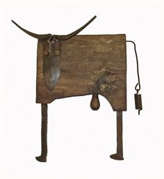Bull from old stable floor boards and recycled metal tools.
