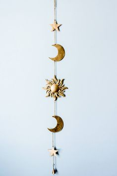 This beautiful piece represents the mesmerizing Sun, Moon, and Stars Each is made from metal, and polished with a shimmering gold. Hangs around 3 feet long. *Ch