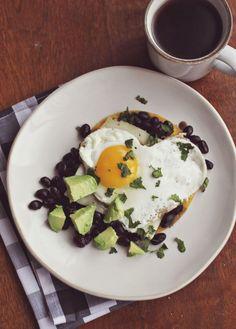 Southwestern Breakfast: Tortilla, Black Beans, Vetebales, Cheese, Eggs, Avocado, and Cilantro