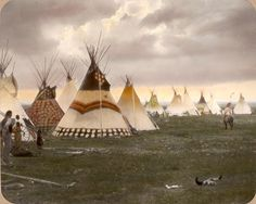 Tipis in Blackfoot/Siksika camp. Montana. Early 1900s. Glass lantern slide by Walter McClintock.
