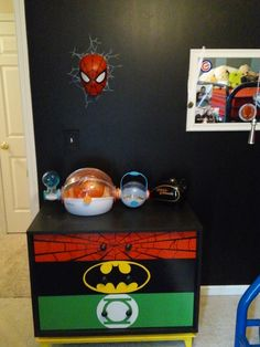 Chalkboard wall for a super creative kid and dresser with his favorite superheroes. Spider-Man light from target. Boy Dresser, Dresser Ideas, Marvel Room, Superhero Room, Kids Bedroom, Bedroom Ideas, Kids Play Area, Kids Corner, Baby Boy Rooms