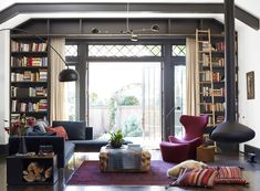 built-ins around awesome windows, lighting, fireplace, colors