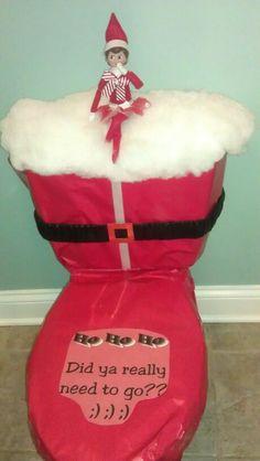 Elf on the Shelf put a Santa suit on the toilet....