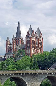 I've see this. It is magnificant! The Catholic Cathedral of Limburg, also known as Georgsdom or Limburger Dom in German after its dedication to Saint George, is located above the old town of Limburg in Hesse, Germany. It is the cathedral of the Roman Catholic Diocese of Limburg.