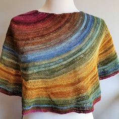 Spill is a shawl worked in rows in a gradient yarn, with short rows used to create a gradual, off-center color change.