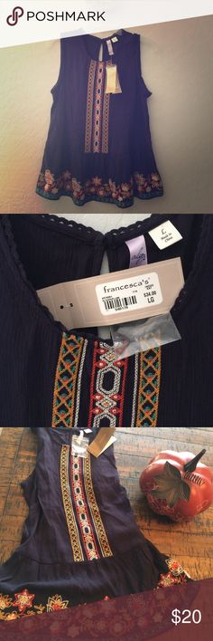 """Francesca's alya sleeveless blouse A sheer, size large, new blouse from Francesca's. it is sleeveless with beautiful embroidery on the front. Solid in the back with 1 button at neckline. Rayon and cotton. It would look adorable with a denim jacket for fall! Approximately 18"""" pit to pit and 23"""" in length. alya Tops Blouses"""