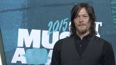 The Walking Dead star Norman Reedus looked fresh in a black vest and shirt as he walked the red carpet at the 2015 Country Music Television Awards.