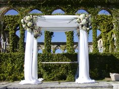 Floral & Linen Chuppah tallit on top different flowers!