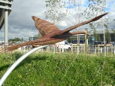 Wooden sculpture of a swan taking flight at Rushden Lakes Shopping Centre Giant Animals, Wooden Animals, Animal Sculptures, Wooden Sculptures, Different Birds, Shopping Near Me, Rear View, Natural World, Outdoor Furniture