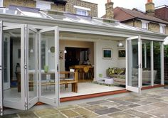017 Folding Sliding Doors in Hammersmith, West London Porch Doors, House Doors, Acordian Doors, Built In Braai, Stacking Doors, Dining Room Walls, Dining Area, Screened Porch Designs, Roof Lantern