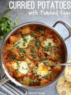 A fast tomato curry sauce takes simple boiled potatoes to the next level! Curried Potatoes with Poached Eggs - #vegetarian #curry