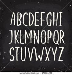 Hand drawn alphabet written with brush pen. Capital letters. Blackboard ABC. Chalk alphabet.