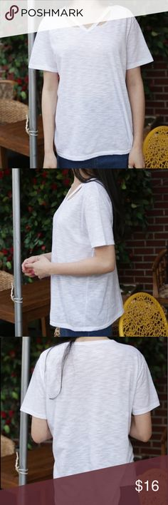 V neck cut put tee shirt beige Good condition. the model is wearing the same shirt in white but the color of the top you will be getting is beige. See photos 5,6,7 for actual color. Can fit XS-M Tops Tees - Short Sleeve