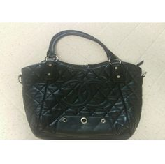 Black Chanel Purse Inspired design. NON Authentic. Was cleaning out my closet and found it in my things. Has a lot of wear on it. The top border of the purse has loose material and tears (last picture). The pink interior is good except there is a stain on the inside. Make me an offer :) Bags Shoulder Bags