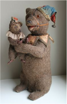 Antique toy performing circus bear nodder with baby bear. Typical German construction with mohair over papier-mache body, collar and cap of silk trimmed with Dresden paper trim. Via Living Tastefully.