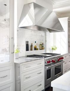 Recessed shelf behind range. Light and Lovely Marble Kitchen   Traditional Home by Mick De Guilio