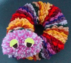Use a Flower Loom To Make a Caterpillar.  Might be good for using up scrap yarn