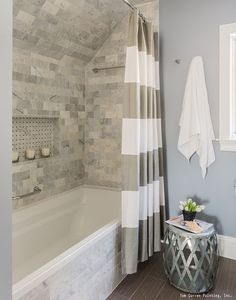 A gorgeous bathroom remodel with a tile shower, white trim and a fresh coat of blue paint. See 10 of the most popular bathroom remodeling ideas homeowners are featuring in their homes.