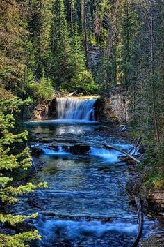 Waterfall in Johnston Canyon, Baniff National Park, Alberta, Canada. Ken Kaminesky. Oh What I would give to have a cabin beside these waters, a place I would never leave.
