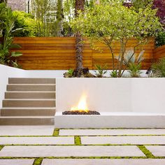 great retaining wall finish - poured concrete and horizontal wood