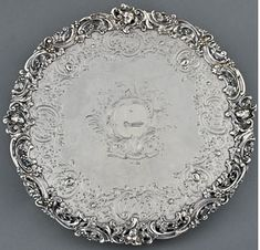Silver Salver, London, England, 1762/63. Silver. H. 1-3/4, Diam. 13-1/2 in. Samuel Courtauld (English, 1720–1765), Engraved with the crest of Lt. Gov. William Bull II (1710–1791) of Charleston, S.C. Stamped on bottom: lion passant, crowned leopard, date letter and a sun over SC. Courtesy, Historic Charleston Foundation, Charleston, S.C