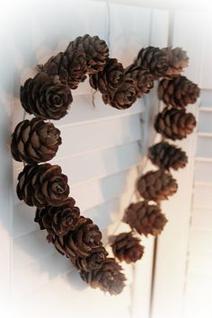 Instead of a heart, cover a wooden letter with pine cones and hang in your fall wreath.