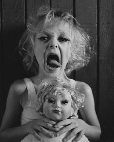 Dakota Fanning, March 2002. Photo by Peggy Sirota. This is a creepy little pic, reminds me of Baby Jane!