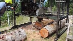 Twin Blade Sawmill - Homemade twin blade sawmill constructed from tubing, circular saw blades, chain, bearings, and a 1200cc engine.