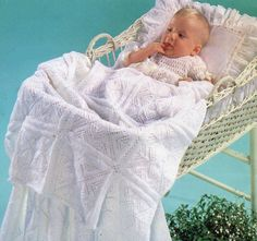 This lovely baby blanket is knitted in carry-along motif squares using 3-ply light fingering weight yarn.  Materials: • 9 50-gram balls, 150
