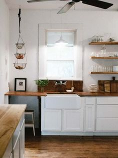 Beautiful old kitchen but updated with white cabinets, hanging fruit bowl and open shelving