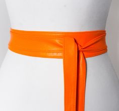 A personal favourite from my Etsy shop https://www.etsy.com/uk/listing/464890164/neon-orange-soft-leather-obi-belt-waist