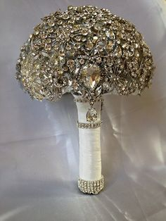 This listing is for a custom made crystal wedding brooch bouquet. It is a Diamond Crystal Bling Jeweled Wedding Bridal Brooch Bouquet.  The total