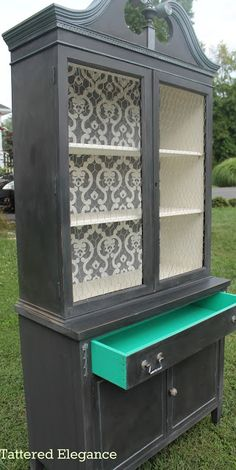 Tattered Elegance: Lincoln's Hat China Cabinet. Like many elements of this cabinet. Wallpaper backing, color and even idea of drawers painted a pop of color.