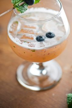 The Lion cocktail with jalapeño, pineapple, blueberry and mint flavors. Get this drink recipe at http://mixthatdrink.com/the-lion/