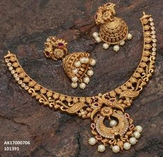 Jewelry refers to ornamental devices worn by persons, typically made with gems and precious metals. Costume jewelry is made from less valuable materials.