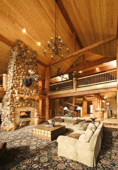 Stunning Log Home Design by Lloyd Architects. Love the rock fireplace for the office