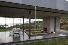 Waiheke Island house designed by Fearon Hay Architects - love the sunken seating area