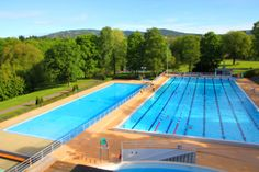 The popular outdoor swimming pool complex Frognerbadet offers two pools, a children's pool, and a diving tower. Outdoor Swimming Pool, Swimming Pools, Oslo, Norway, Northern Lights, Tower, Public, France, Bath