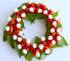 Caprese Christmas wreath (cherry tomatoes attached to mozz balls with toothpicks on top of basil)