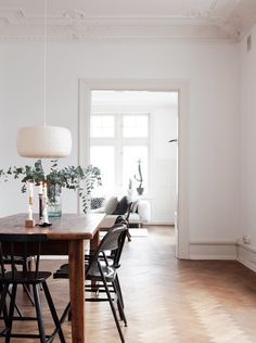 Herringbone floor, wooden table and black chairs. Simple, classic and beutiful | Interior inspiration for the minimal home