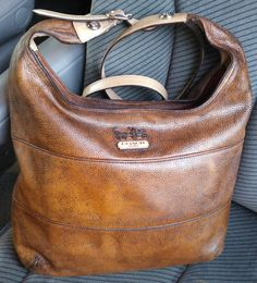 Coach bag after dying and conditioning the leather and applied protectant. Still soft and luxurious feeling, but looks so much better!