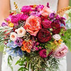 A colourful bloom to brighten this rainy Wednesday #weddingwednesday #weddingflowers #bridebouquet #fushia #peach #coral #crimson #londonblog #londonblogger #weddingblog #weddingblogger
