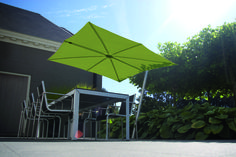 This innovative shade structure boasts a unique geometrical, ergonomic design which allows for easy positioning for maximum shade; such as the desired height, the angle of inclination and 360° rotation. - Umbrosa SPECTRA in Olive