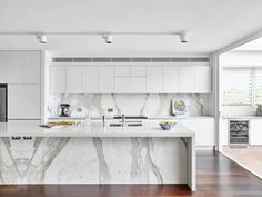 Modern Kitchen Interior Remodeling 30 Gorgeous Grey and White Kitchens that Get Their Mix Right - Designing your kitchen in grey and white need not produce a sterile look. Grey cabinets, white counters, and gray wood floors can create a warm look.