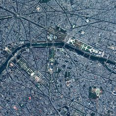 Paris, France - photo from dailyoverview (11/14/15);  The Arc de Triomphe is in the top left corner at the center of the spoke-like intersection.  The River Seine flows through the city past the Eiffel Tower and Champ de Mars on the left, and the Grand Palais in the center. The Louvre museum is at the east end of the garden beside the palace.  The large green area in the lower right is Le Jardin du Luxembourg.  The Cathedral of Notre Dame is at the far end of the island on the right (not…