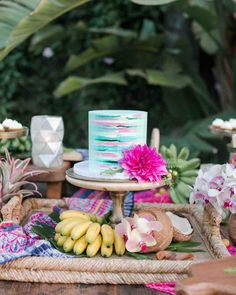 An Island-Inspired, Backyard Wedding Anniversary Dinner | Martha Stewart Weddings - The small vanilla cake was filled with passionfruit cream and coconut cream cheese frosting and covered with a vanilla buttercream. Designed by Sweet and Saucy Shop to look like a tropical, watercolored dream, it anchored the table of island-inspired treats. JD loved the cake so much, he ate a slice for breakfast the following morning.