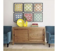Art from Crate and Barrel. DIY with cute scrapbook paper.